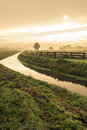 Little river in countryside at sunrise