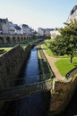 Little river garden along walls vannes city blue sky Royalty Free Stock Image