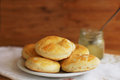 Little rolls on white plate or biscuits are with napkin and honey jar background Stock Photography