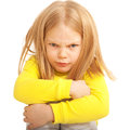 Little sad and angry child isolated on white background Royalty Free Stock Photo