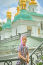 Little sad girl beautiful near orthodox church Stock Images