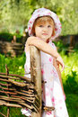 Little sad girl near fence Royalty Free Stock Photography
