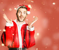 Little santa helper spreading christmas cheer with open hands in falling snow what x mas already question mark Royalty Free Stock Image