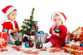 Little santa helpers two decorating a tree Royalty Free Stock Image