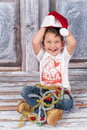 Little santa joyful boy in a studio wearing hat Stock Image
