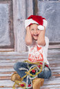 Little santa joyful boy in a studio wearing hat Stock Photos