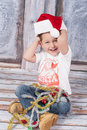 Little santa joyful boy in a studio wearing hat Royalty Free Stock Images
