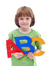 Little school boy with large letters Royalty Free Stock Photo
