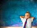 Little schoolboy with blackboard in background Royalty Free Stock Photos