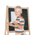 Little schoolboy cute drawing on school board over white Royalty Free Stock Photography