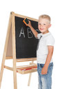 Little schoolboy happy writing on a blackboard over white Royalty Free Stock Photo
