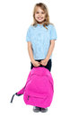 Little schoolgirl posing with pink backpack Stock Photo