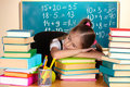 Little schoolgirl sleep in classroom Stock Images