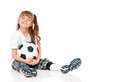 Little schoolgirl soccer ball sitting floor isolated white background Stock Images