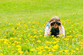 Little scout young explorer in a dandelion field Royalty Free Stock Photography