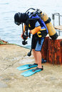 Little scuba diver before diving into sea Stock Images