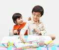 Little sibling boy painting water color together Royalty Free Stock Photo