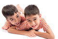 Little siblings boy brother smiling laying down together with happy face Royalty Free Stock Photo