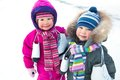 Little skaters in wintertime Stock Images