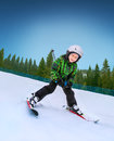 Little skier going down from snowy hill Stock Photography