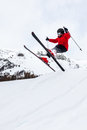 Little skier jumping in the snow male kid performs a high jump with ski winter season red jacket valle d aosta italy europe Stock Photography