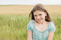 Little smiled girl on the wheat field background Royalty Free Stock Photo