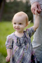 Little smiling baby holding father's hand Royalty Free Stock Photo