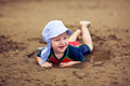 Little smiling boy in the mud puddle Royalty Free Stock Photo