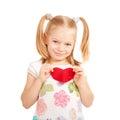 Little smiling child holding Felt heart. Royalty Free Stock Photo