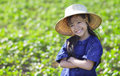 Little smiling girl farmer on green fields Royalty Free Stock Image