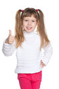 Little smiling girl holds her thumb up a pretty against the white background Royalty Free Stock Photos