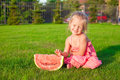 Little smiling girl with a piece of watermelon in hands this image has attached release Stock Photo