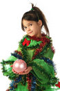 Little smiling girl with pink Christmas decoration Stock Image