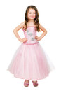 Little smiling girl posing in nice pink dress isolated on white Royalty Free Stock Photo