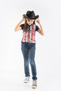 Little smiling girl wearing cowboy hat on  white background Royalty Free Stock Photo