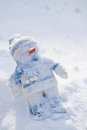 Little snowman with carrot nose in the snow Royalty Free Stock Images