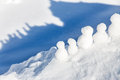 Little snowmen figures standing on a mountaintop Royalty Free Stock Photo