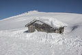 Little snowy mountain hut taken on february th on my way up to top of the dobratsch in villach it was one of the few sunny days Royalty Free Stock Photo