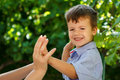Little son playing with mother hands outdoor Royalty Free Stock Photos