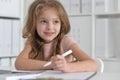 little student girl making homework