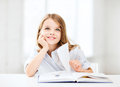 Little student girl studying at school education and concept Royalty Free Stock Image
