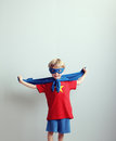 Little superhero a young boy dreams of becoming a Stock Images