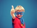 Little superhero a young boy giving you a thumbs up Stock Photos