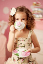 Little sweet girl with tea cute and Stock Photo