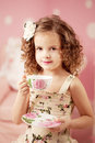 Little sweet girl with tea cute and Royalty Free Stock Photos