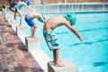 Little swimmers ready to jump in pool Royalty Free Stock Photo