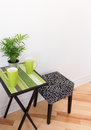 Little table with bright green cups and plant Royalty Free Stock Image