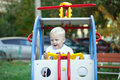 Little three year old boy playing on the playground Royalty Free Stock Photo