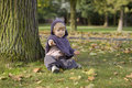 Little toddler in an autumn park Royalty Free Stock Photo