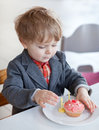 Little toddler blowing two birthday candles Stock Photo